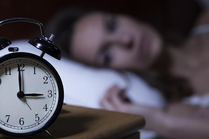 Woman having trouble falling asleep