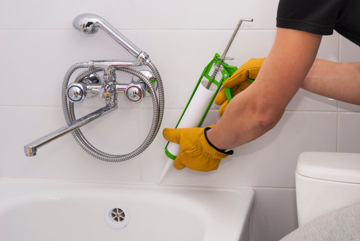 Caulk around tubs to prevent plumbing leaks