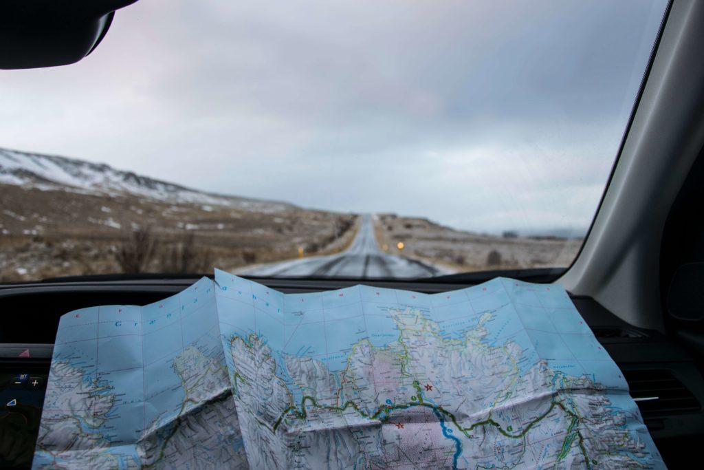 Traveler using map