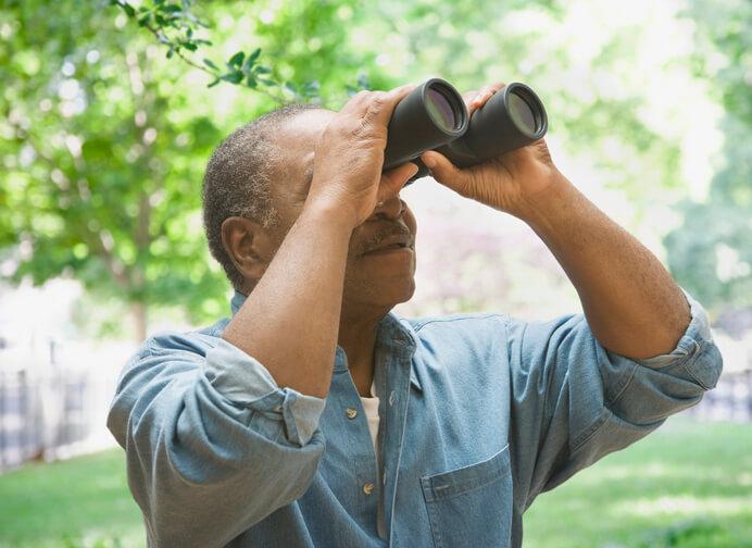 Man Bird Watching During 30 Day Wellness Challenge