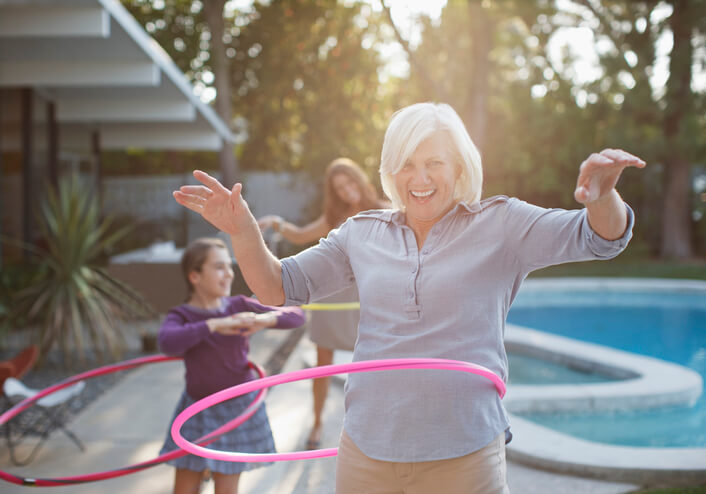 Woman Exercising With Hula Hoop For Wellness Challenge